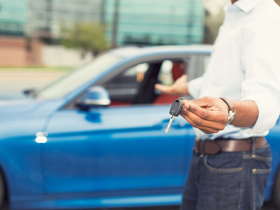 Premier Auto Detailing Blog: man holding keys and wondering How to Make the Most Money When Selling Your Car