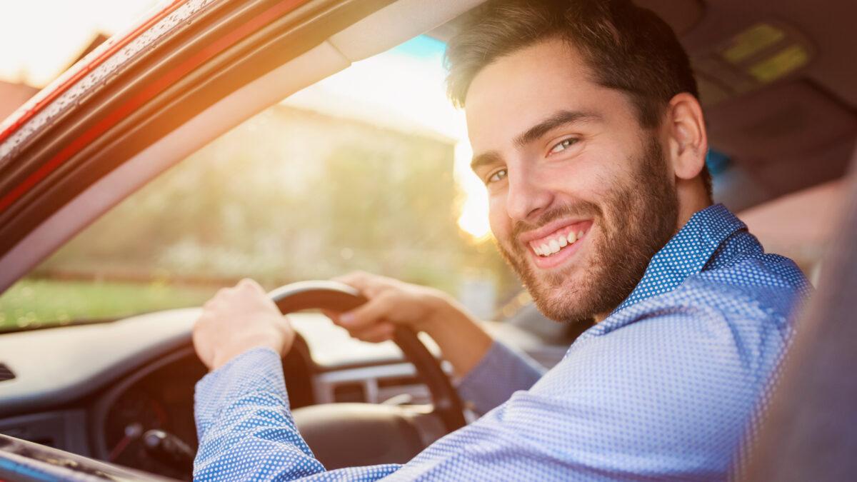happy man driving his car
