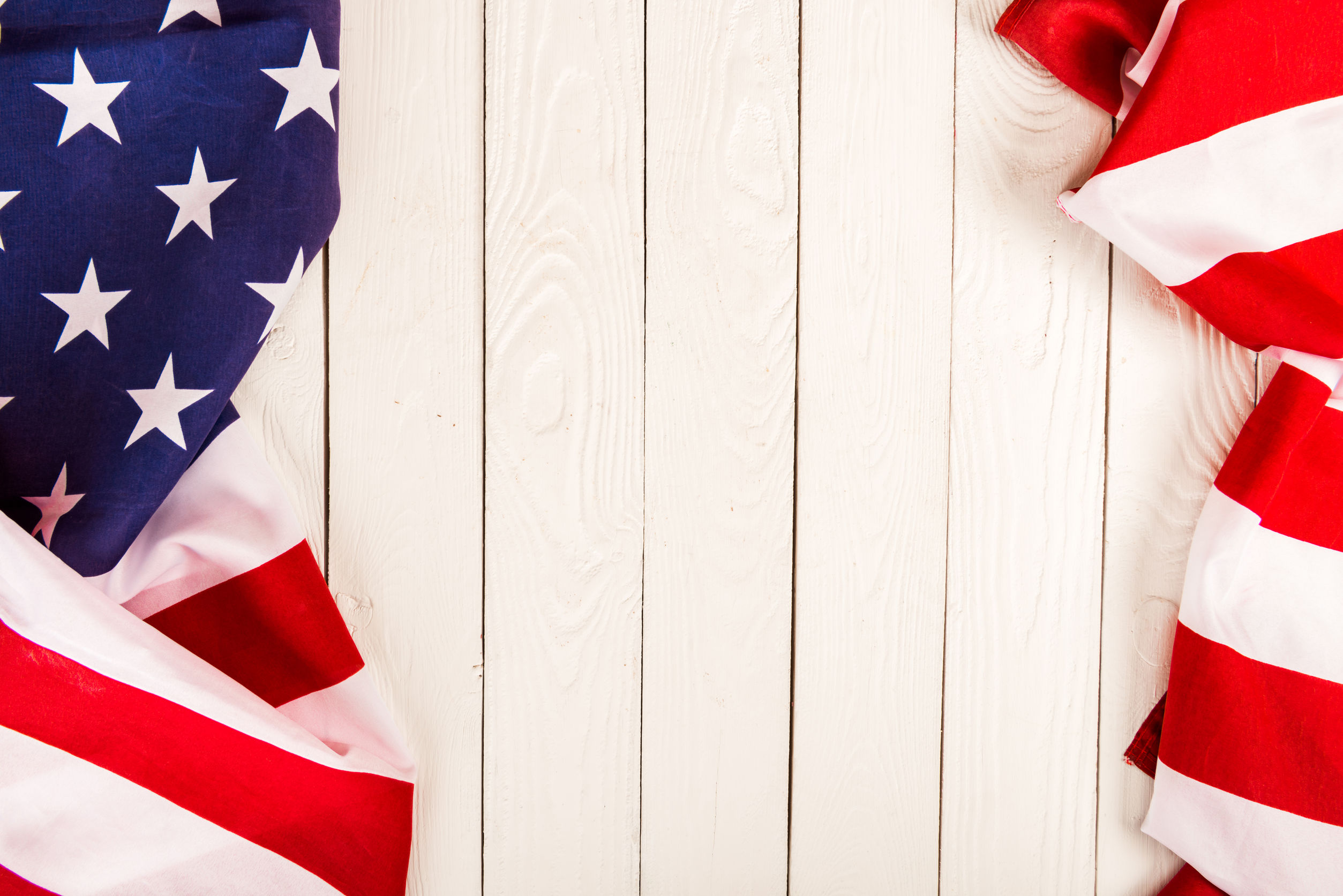 American flag on white wooden background