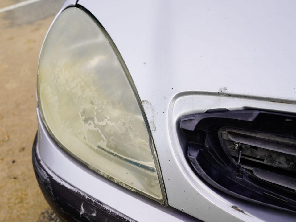 a car with dirty headlights in need of a restoration service